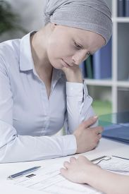 foto of chemotherapy  - Portrait of young businesswoman after chemotherapy treatment - JPG