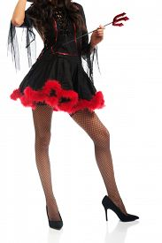 stock photo of trident  - Close up on woman legs wearing devil clothes - JPG
