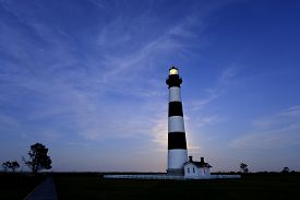 picture of outer  - Bodie Lighthouse on the Outer Banks of North Carolina illuminated by full moon rising behind it - JPG