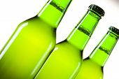 Bottles of beer with water-drop on white background