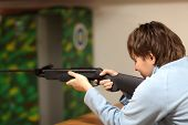 Woman Is Aiming By Air Rifle