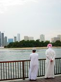 image of yashmak  - arab people on the wonter front in uae sharjah - JPG