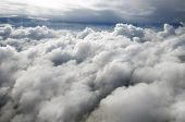 Постер, плакат: Above the clouds in the sky
