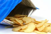 picture of potato chips  - potato chips spilling from bag on white background - JPG