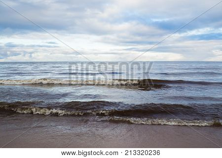 poster of Landscape sea waves and the cloudy -natural elements water Ocean waves. Wild sea storm - hazardous weather. The waves lapping on the shore.