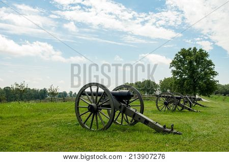 Row Of Cannon Artillery Pointing