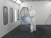 foto of auto repair shop  - The image of painter works in a spray booth - JPG