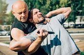 Kapap Instructor Demonstrates Martial Arts Self Defense Knife Attack Disarming poster