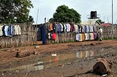 JUBA â?? JUNE 11: An unidentified man arranges shirts for sale at a clothing store on a downtown str