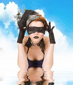 picture of vaudeville  - Girl blindfolded and dressed in underwear on sky background - JPG