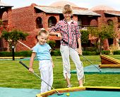 picture of miniature golf  - Children playing in golf - JPG