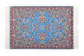 Rectangular blue carpet horizontally lies on  white background