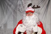 Funny Santa Hat. Santa Claus wears a Funny Santa Hat. poster