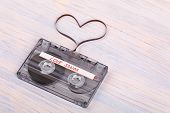 Audio Cassette Tape On Wooden Background. Audio Film Shaping Heart poster