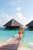 Water Villas And Sexy Lady. Welcome To Paradise!