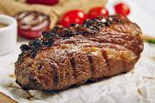 Постер, плакат: Gourmet Grill Restaurant Steak Menu Tri Tip Beef Steak on Wooden Background Black Angus Prime Bee