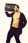 Caucasian Sexy Young Macho Holding Board With Sale Inscription poster