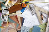 Architect or interior designer workplace desk and design tools with lots of construction material sa