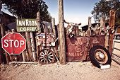 stock photo of motel  - Old Route 66 rusty cafe and motel signs in desert of Arizona - JPG
