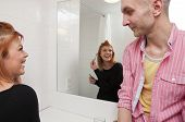 couple talking in hotel bathroom