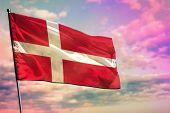 Fluttering Denmark Flag On Colorful Cloudy Sky Background. Denmark Prospering Concept. poster