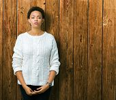Beautiful young african american woman wearing sweater over isolated background Relaxed with serious poster