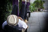 Homeless Man Sleeps On The Street Chair. poster