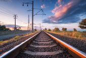 Railroad And Beautiful Sky At Sunset In Summer. Rural Industrial Landscape With Railway Station, Blu poster