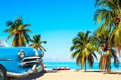 The Tropical Beach Of Varadero In Cuba With American Classic Car, Sailboats And Palm Trees On A Summ poster
