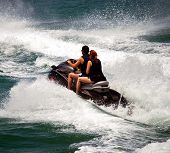 Boy And Girl On A Jetski
