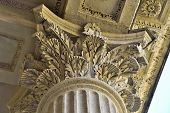 Column Capital Close Up - Architectural Element Of Antique Buildings Decoration. Upper View Of Stone poster