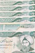 stock photo of ten thousand dollars  - close up of ten thousand iraqi dinar notes - JPG