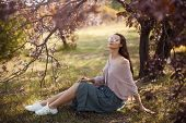 Beautiful Young Woman Enjoying A Sunny Spring Day In A Park During Cherry Blossom Season. Romantic C poster