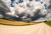 Hdr Panorama On Asphalt Road Among Fields In Evening With Awesome Black Clouds Before Storm poster