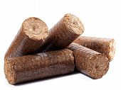 stock photo of briquette  - Natural source of energy in the form of wooden briquettes on a white background - JPG
