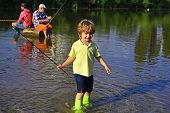 Young Boy Fishing In A Forest River. Little Fisherman Ready To Go Fishing. Little Child Fishing On R poster