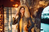 Autumn Season. Gorgeous Pretty Woman In Furry Coat Jacket Stand Urban Background. Trendy Outfit. Her poster