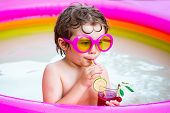 Little Child Boy Having Fun In The Pool. Cute Kid Relaxing On Swimming Pool. Little Child Boy Relaxi poster