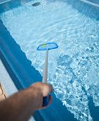 working with a pool skimmer