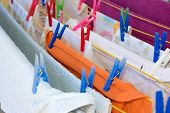 Hanging Clothes And Colorfull Plastic Cloth Pegs