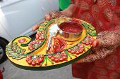 stock photo of jain  - A decorated dish full of different objects related to the mehendi ritual in traditional hindu and jain marriages - JPG