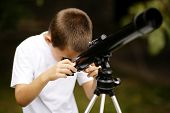 little boy with telescope