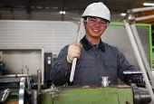 Asian Technician At Tool Workshop