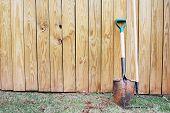 Shovel And Rake Leaning On Fence