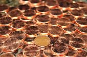 picture of copper coins  - one old penny in the midst of shiny new pennies - JPG