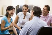 foto of ethnic group  - Group of work colleagues sat together talking - JPG