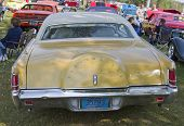 Yellow Lincoln Continental Rear View
