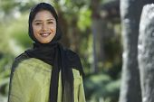 picture of dupatta  - Portrait of a happy Indian woman wrapped with black and green dupatta - JPG