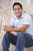 Man Sitting On Staircase Smiling