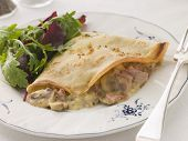 Savoury Pancake Filled With Ham Cheese And Mushrooms With Dressed Salad